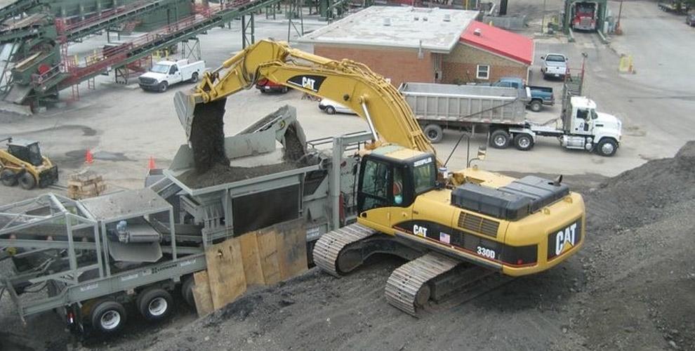 backhoe dumping soil